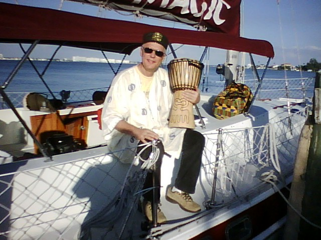 Buddy Helm sitting with Drum on the yacht Magic